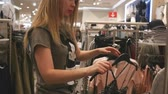 shopaholic : blonde shopping at a womens clothing store