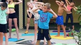 görev : Russia, Anapa, 2018: Children do morning exercises under the guidance of an outdoor trainer Stok Video