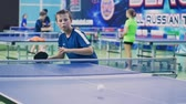 tenisz : Russia, Anapa, 2018: Summer gathering of young athletes in table tennis. Competitions in between the children. Preparation for competitions in table tennis Stock mozgókép