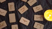 paper bag : Wooden rune wheel. runic layout and candles, 4k, slow-motion shooting