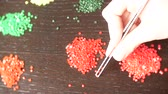 decorar : The mosaic process, the girls hand holding tweezers, making a mosaic. 4k, close-up