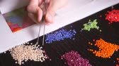 tweezers : The mosaic process, the girls hand holding tweezers, making a mosaic. 4k, close-up