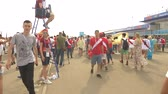 festividades : SOCHI, ADLER, RUSSIA - June 26, 2018: FIFA 2018. Football fans of the national team of Peru and Australia are going to the match at the stadium Fisht in the Olympic village. 4K, EDITORIAL Stock Footage
