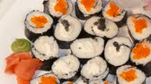 Decorate sushi rolls with black caviar