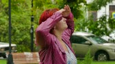 sloppy : A wet girl looks at the sky and waits for the end of the rain. Stock Footage