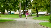 глупый : girl with an umbrella jumping on an empty park