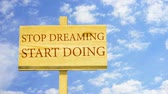 word cloud business : Stop dreaming start doing. Words on a wooden sign. Stock Footage