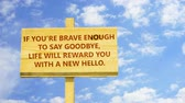 say goodbye : If you are brave enough to say goodbye, life will reward you with a new hello. Words on a wooden sign. Stock Footage