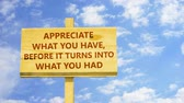 szál : Appreciate what you have before it turns into what you had. Words on a wooden sign.