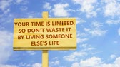 tál : Your time is limited. So do not waste it by living someone elses life. Words on a wooden sign.