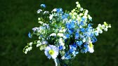 lily of the valleys, forget me nots and daisies wildflowers bouquet loop turning up close up