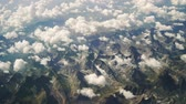The view from the airplane of the mountains and clouds. Stock Footage