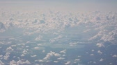 tableland : The view from the airplane window at the clouds and the lake.
