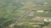 The view from the plane to the settlements and road over the Moscow region. Stock Footage