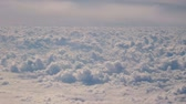 overcast sky : Flying a plane over a large number of small clouds.