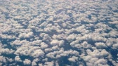 tableland : Flight over a large number of small clouds.