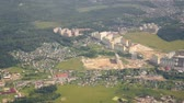 The view from the airplane window to the settlements and new houses over the Moscow region. Stock Footage