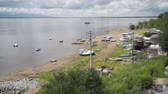 riverbank : Boats on the bank of Amur river.