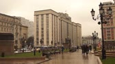 szövetségi : Moscow - Nov 19, 2017: Building of the State The Kremlin of the Russian Federation and the Manezhnaya square on a cloudy day Stock mozgókép