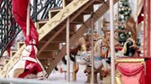 épült : Traditional Vintage Carousel with Colorful Wooden Circus Horses. Entertainment, holidays, joy concept.