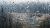 revisão : Rain drops on the funicular glass in motion, view from inside the closed ski lift, 4k