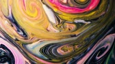 milk pouring : Abstract psychedelic background. Pink paint mixed with multi-colored liquid in slow motion