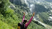 conquest : Woman raises her hands up in the mountains on an ascent in a hike. The concept of victory and success, the achievement of the goal