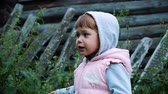 fence : Little girl sings in the village, slow motion Stock Footage