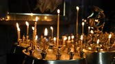 chvála : Wax candles burn and stand on the sand in the censer of the Orthodox ancient temple
