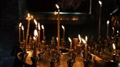 fame : Wax candles burn and stand on the sand in the censer of the Orthodox ancient temple, slow motion Stock Footage