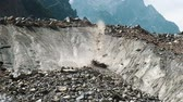 landslide : Rockfall in the mountains, huge boulders fall from the glacier, slow motion
