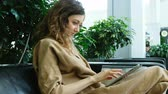 наркомания : Businesswoman sitting on the couch business center and using a tablet