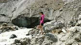 sandalet : Girl tourist goes down the rocks to a mountain river