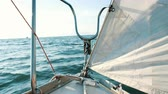 emerald water : Bow of a sailing yacht closeup swings on the waves in the open sea Stock Footage