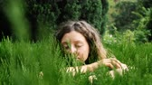 sonhador : Young curly woman showing love to nature and the environment, hugging a plant Stock Footage