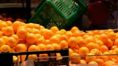 vitaminok : Hand picking orange and put in bag. Fresh fruits selling in supermarket