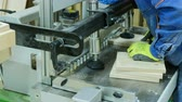 공학 : modern CNC drilling machine drills holes in wooden boards, furniture factory, furniture production, close-up