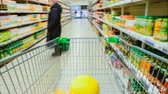 commode : Time Lapse of the Shopping Cart Moving Between Various Aisles and Section in the Big Supermarket. Inside Trolley Various Healthy Items and Convenience Food.