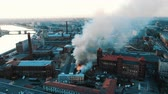 Firefighters extinguish a burning building, aerial view Stock Footage