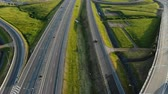 construcción de carreteras : automobiles drive along grey turning circle in sunny morning