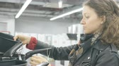 kız : blue-eyed girl chooses a frying pan in a hardware store