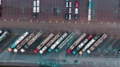 marcado : car transporter trucks stand on huge parking lot aerial view