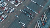 bisarca : autos drive and park on warehouse parking lot upper view Filmati Stock