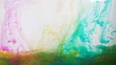 farba : beautiful pink and blue transparent ink mixing into rainbow Wideo