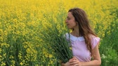 belo : Young Woman in Vintage Dress Relaxing Holding Herbs Flowers Spring Field HD