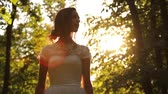 fashion : Vintage Wedding Dress Girl Forest Summer Sun Flare background HD Stock Footage