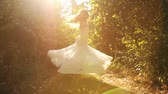 fashion : Beautiful Female Spinning Bride Dress Slow Motion Forest Nature