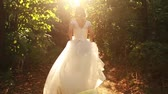 fairytale : Young Woman Beauty Running in Forest Runaway Bride Concept Stock Footage