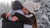 capô : Happy Young Couple Hugging Outdoors Nature Winter Snow Stock Footage