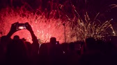 Happy Crowd Silhouettes Watching Fireworks Display Taking Photos With Smartphone Technology Lifestyle Concept